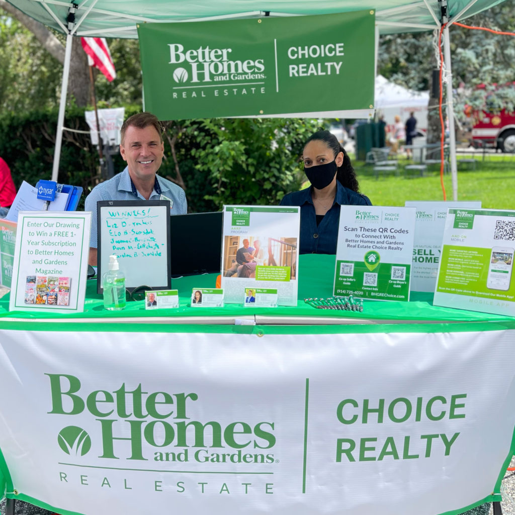 Better Homes and Gardens Real Estate Choice Realty Principal Broker John Crittenden (Left) and Real Estate Agent Diana Gay (Right) at the 2021 Scarsdale Sidewalk Sale Sponsored by Scarsdale Business Alliance